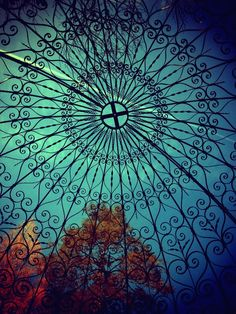 Iron work gazebo. Inspiration for a multi toned blanket with black embroidery over.