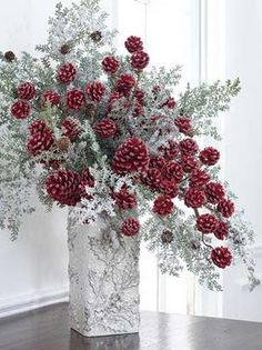 Red Pinecone Winter Floral Arrangement (uses 5 Snowy Cedar Branches and 3 red pine cone branches) [http://shelleybhomeandholiday.com/more/photo-gallery/christmas-decorating-photo-gallery-enter-here/red-pinecone-winter-floral-arrangement/ & www.razimports.com]