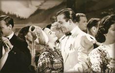 SPRINGTIME IN THE ROCKIES (1942) - Broadway dancer John Payne enjoys the company of his his Latin secretary Carmen Miranda - Directed by Irving Cummings - 20th Century-Fox - Movie Still.
