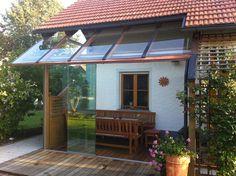 Wintergarten Holz & Glas - geöffneter Zustand - Windschutz