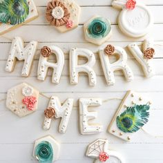 Instagram photo by | SPILLED MILK CAKERY | marry me engagement cookies:  peacock feathers, teal, burlap, rustic wedding.