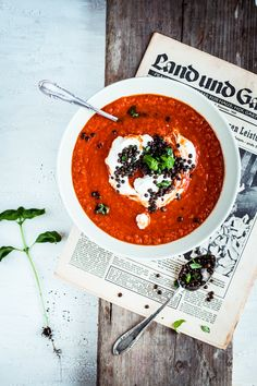 Tomato soup and a newspaper! Love this food photography!