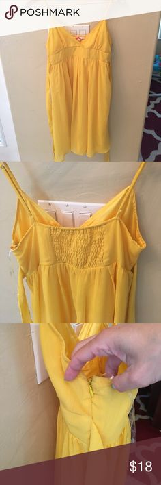NWOT sundress Forever 21 bright yellow sundress. Lined, elastic back, side zipper and straps to tie in the back. Midi length Forever 21 Dresses Midi