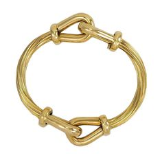 Italian Reeded Gold Bangle Bracelet   From a unique collection of vintage bangles at http://www.1stdibs.com/jewelry/bracelets/bangles/
