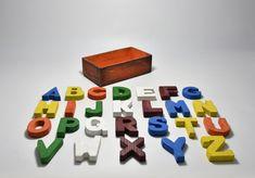Letters #1 Materials: Wood Dimensions: 6cm x 1.5cm x 7.5cm