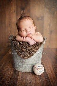 Hello baby! 30 ways to photograph your newborn newborn photos, sports themed newborn photos #baby #photography #newborn