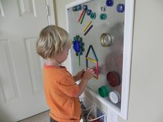 Cute magnetic board to keep little fingers busy!