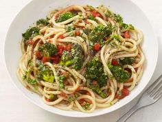Change things up for pasta night with this hearty Pasta with Broccoli and Almond Tomato Sauce, made with roasted broccoli and a pesto-inspired sauce using almonds and basil.