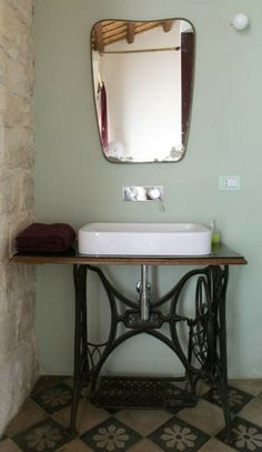LOVE! If I hadn't just purchased a pedestal sink, I'd SO do this. In fact, maybe I'll get rid of the sink and do it anyway. LOL