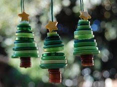 I just love these button Christmas tree ornaments. You need some small brown buttons and an assortment of shades and sizes of green butt...