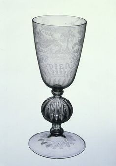 A glass from 1581 (possibly made as a gift to John Dier who's name is on it).  It is large enough to be a beer glass and is beautifully engraved.