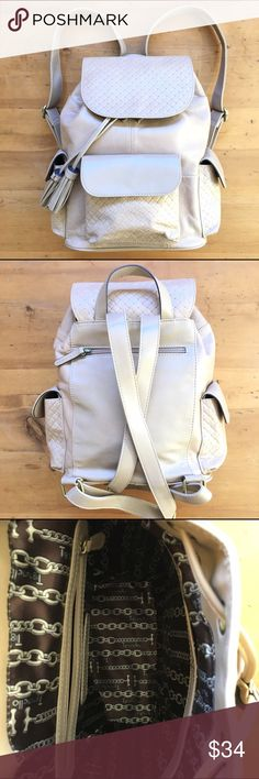 Tignanello Leather Backpack This bag is in excellent condition. Two side pockets one pocket in front zip pocket in back drawstring closure side zipper pocket inside camel tan color adjustable straps handle on top 13 inches long 12 inches wide wonderful basic 💕💕 Tignanello Bags Backpacks
