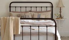 Neutral country bedroom with iron bed