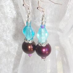 These boho-style dangles feature a combination of burgundy-purple faux pearls and satiny blue glass beads, with sparkling accents in Simple Elegance, Blue Beads, Handicraft, Silver Color, Boho Fashion, Dangle Earrings, Glass Beads, Great Gifts, Dangles
