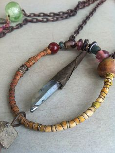 Long Rustic Tribal Pendant Necklace Recycled Indian Beads Crystal Point and Pyrite Chunks.