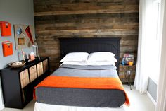 small bedroom with wooden accent wall