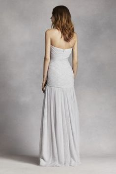 Look effortlessly chic in this long soft bobbin net drop waist gown!  Strapless pleated bodice with ultra-feminine sweetheart neckline.  Drop-waist, flare skirt gives this gown an ethereal feel.  Sizes 0-26.  Fully lined. Back zip. Imported. Dry clean only.