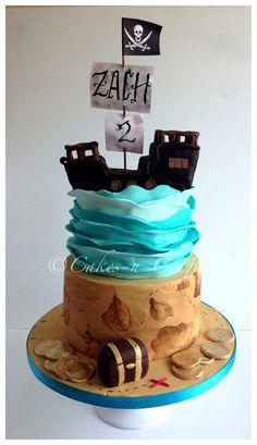 2 tier pirate cake with edible pirate ship - 2 tier cake with rkt pirate ship, wave top tier and hand painted treasure map bottom tier
