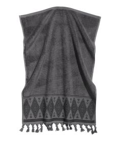 Check this out! Hand towel in soft cotton terry with an embroidered pattern and tassels at lower edge. Hanger loop on one short side. - Visit hm.com to see more.