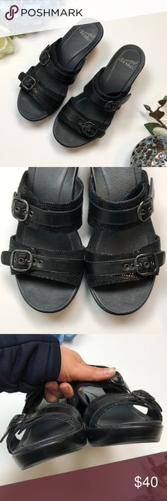 """Dansko Black Leather Sandals 37 / US 7 D4 Well made and perfect for summer!  Dansko brand, size 37 / US 7.  Measurements: Heel Height: 2.5""""  A little scuffing on toes and one sharpie mark on sole but otherwise they look brand new.  Closet policies: ❌ No trades, no holds ✅ I consider all reasonable offers 🛍Bundle and save 15% 📫It is my goal to ship same day or next business day ❓If you have questions please ask!  Inventory code: 318135d Dansko Shoes Sandals"""
