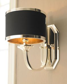"""Tuxedo"" Sconce at Neiman Marcus.  $192 to $150 Sleek silver and black make this quite the distinctive fixture. Crafted of silver-plated metal with a black hardback shade. Uses one 60-watt bulb. 7""W x 10""D x 12""T. Mounting hardware is included. Imported"