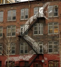 Neat building art! Loving the wave of graffiti style art flooding the web these days.