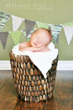 newborn photo - love the bunting in the background.