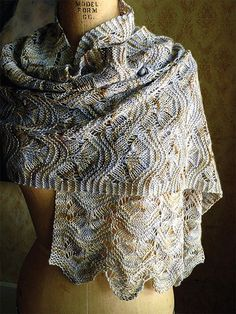 Knitting Pattern for Easy Hillflowers Scarf or Shawl - Rectangular wrap knit in with an easy to remember lace pattern in 2 pieces and grafted at the center back for symmetry. It works well with tonal variegated colorways. Can be resized by adding/subtracting repeats or worked in a different gauge by changing yarn weight and needles. Designed by Anne Hanson. Rated easy by Ravelrers and the designer.