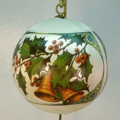 This is a vintage Hallmark ornament from the Antique Card Collection Design in 1978. It is an ivory colored soft sheen satin ball with pretty bells an
