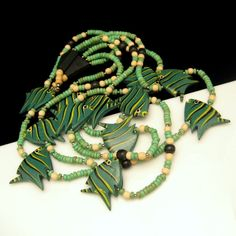 LOVE LONG CHUNKY NECKLACES? This vintage necklace is not only super-long, but has fabulous, large green fish beads! $69.95 See more great vintage necklaces in my eBay store: http://stores.ebay.com/My-Classic-Jewelry-Shop/Necklaces-/_i.html?_fsub=1589284016&_sid=102404336&_trksid=p4634.c0.m322 :)