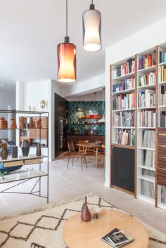 beautiful designer loft in Berlin, colorful 60s kitchen decor, pottery collection, black and white rug, mid century modern furniture