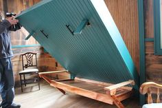 home made murphy bed. the best part about this is if you go to the site you can see that the wall has been built with the murphy bed in mind so it is bumped out there. So when folded up you have a flat wall