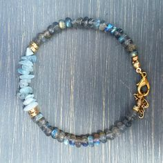 Gorgeous 'A' grade labradorite gemstone beads & ice blue aquamarine gemstone chip beads. Finished with gold filled findings, lobster clasp & ring, and chain extender. Design to fit most wrists.                                                                                                                                                                                 More