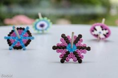 Homemade spinning tops of fuse beads
