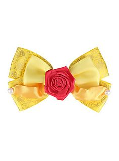 "<p>Hair bow from Disney's <i>Beauty And The Beast</i> with a design inspired by Belle's yellow dress.</p>  <ul> <li>4 1/2"" across</li> <li>Imported</li> </ul>"
