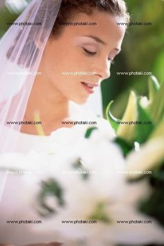 http://www.photaki.com/picture-bride-holding-bouquet_1323418.htm
