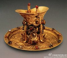 Antique: Traditional Chinese gold wine cup