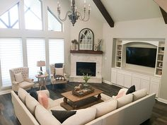 Corner Fireplace Fireplace surround Floor and Décor Rock Ridge Glacier Split Face Quartzite The living room features a corner fireplace and built-in media cabinets