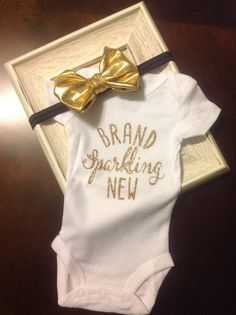 Hey, I found this really awesome Etsy listing at https://www.etsy.com/listing/222937781/brand-sparkling-new-gold-onesie-newborn