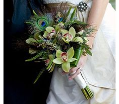 Our funky peacock feather bouquet of green cymbidiums, purple veronica, ti leaves, seeded euc, purple trachilium and of course, peacock feather feathers. Photo taken by Jeff Tisman.