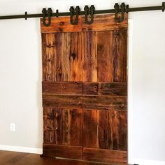 These barn doors by @aclinganfurniture are beautiful. They are made out of reclaimed barn wood salvaged from a barn from the 1820's. Hung with our Modern Industrial Horseshoe.