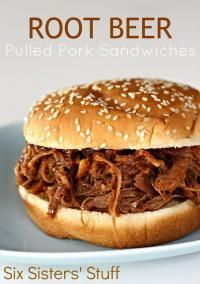 Six Sisters Slow Cooker Root Beer Pulled Pork Sandwiches are a moist and tender pork with a sweet bbq taste!  Our kids devour these!!