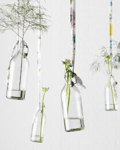 """Display your fondness for flowers with """"floating"""" vases. Secure a long strip of fabric to a hook in the ceiling. Tie the loose end to a bottle and then add a few flowers and a bit of water to keep them looking fresh."""