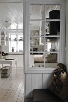 Upcycle an old window into the upper portion of a partial wall. I love the molding!