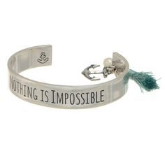 "1/2"" wide; worn silver tone cuff style bracelet engraved ""Nothing is Impossible"" with an accenting mint tone tassel and anchor charms."