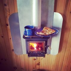 Meanwhile at the cabin…warming up leftover pizza and tea on the Cubic Mini wood stove Meanwhile at the cabin…warming up leftover pizza and tea on the Cubic Mini wood stove Travel Trailer Decor, Rv Travel Trailers, Mini Wood Stove, Rv Wood Stove, Wall Tent, Rocket Stoves, Tiny Spaces, Small Space, Woodworking Projects Plans