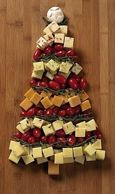 use pretzel sticks for bottom of tree and salami and pepperoni instead of tomatoes. Savoury Christmas tree platter <3  (Courtesy of christmas_countdown on Instagram)