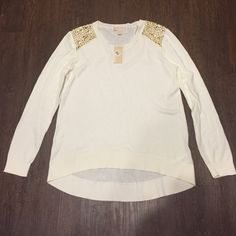NWT Michael Kors Gold Shoulder Sweater Brand new Ivory sweater with gold stud detail on shoulders. I am an XS and modeling a large! Please check measurements. Shoulder to longest point is 28 inches. Bust is 19 inches. No trades and no holds. 20% off of bundles. One day shipping. MICHAEL Michael Kors Tops Sweatshirts & Hoodies