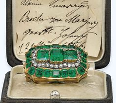 AN ANTIQUE EMERALD AND DIAMOND BROOCH. Centring upon three rectangular-cut emeralds in an old-cut diamond frame, to the rectangular-cut emerald surround, mounted in gold, cm, in brown leather case. Royal Jewelry, Emerald Jewelry, Fine Jewelry, Gold Jewellery, Emerald Rings, Ruby Rings, Emerald Diamond, Emerald Pendant, Jewellery Shops