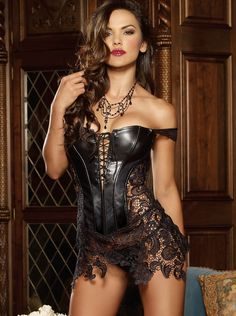 Two-piece faux leather and Venice lace chemise lingerie dress set. Includes a fully boned corset style chemise with lace-up front, uneven lace hem, and matching thong. Zipper back closure. Other accessories not included.